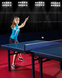 Girl table tennis player at sport hall Royalty Free Stock Photography