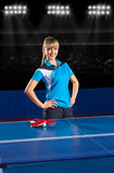 Girl table tennis player at sport hall Royalty Free Stock Image