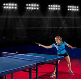 Girl table tennis player at sports hall Stock Photography