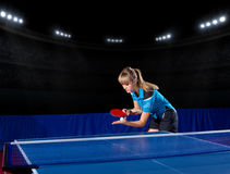 Girl table tennis player at sports hall Stock Images