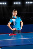 Girl table tennis player at sports hall Stock Photo