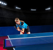 Girl table tennis player at sports hall Royalty Free Stock Images