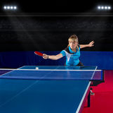 Girl table tennis player at sports hall Royalty Free Stock Image