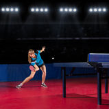 Girl table tennis player at sports hall Royalty Free Stock Photos