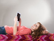 Girl with tablet Royalty Free Stock Photography