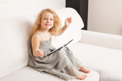 Girl with tablet Stock Image