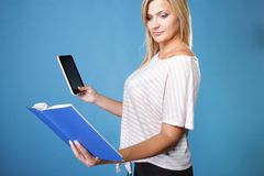Girl with tablet computer ebook reader and book Stock Photos