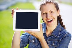 Girl with tablet computer Stock Image