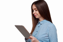 Girl with a tablet in hand smiling Stock Photos