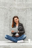 Girl with a tablet in hands Royalty Free Stock Photography