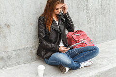Girl with a tablet in hands Royalty Free Stock Image