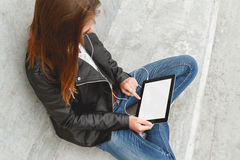 Girl with a tablet in hands Stock Image