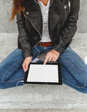 Girl with a tablet in hands Royalty Free Stock Photo