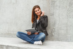 Girl with a tablet in hands Royalty Free Stock Photos