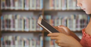 Girl on tablet in Library Stock Images