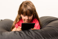 Girl with tablet Stock Photography