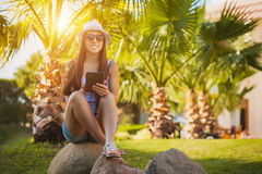 Girl with tablet in the palm garden Stock Photos