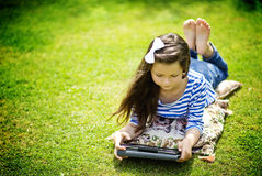 Girl with tablet in a park Stock Image