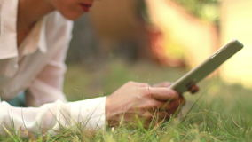 Girl with Tablet in the Park 02 Royalty Free Stock Photography