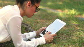 Girl with Tablet in the Park 01 Royalty Free Stock Photos