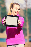 Girl with tablet in park. royalty free stock image
