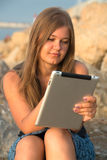 Girl with tablet pc Royalty Free Stock Image