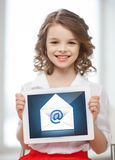 Girl with tablet pc and envelope icon. Picture of little girl with tablet pc and envelope icon Royalty Free Stock Photos