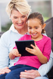 Girl tablet pc grandma Stock Photography