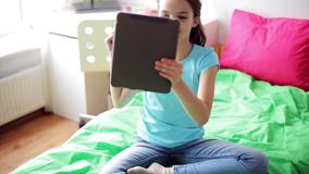 Girl with tablet pc having video chat at home stock video footage