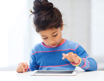 Girl with tablet pc at home Stock Photos