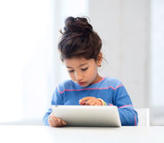 Girl with tablet pc at home Stock Photography