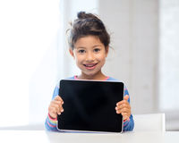 Girl with tablet pc at home Royalty Free Stock Photo