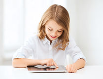 Girl with tablet pc at school Stock Image