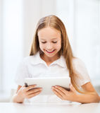 Girl with tablet pc at school Royalty Free Stock Image
