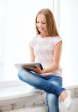 Girl with tablet pc at school Stock Photography