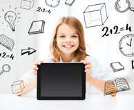 Girl with tablet pc at school. Education, school, technology and internet concept - little student girl with tablet pc at school Royalty Free Stock Images