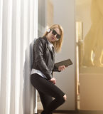Girl with tablet standing near column Stock Photography