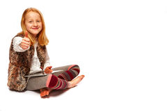 Girl with Tablet thumbs up. Young girl with tablet thumbs up stock photos