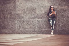 Girl with tablet is walking in the downtown Stock Photos