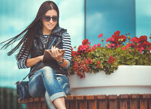 Girl with tablet is walking in the downtown Royalty Free Stock Photo
