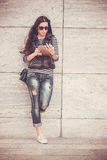 Girl with tablet is walking in the downtown Royalty Free Stock Photography