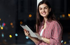 Girl with Tablet on Windowsill royalty free stock photo