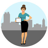 Girl with tablet. Woman showing something displayed on tablet pc. A modern girl in a big city.rGirl with tablet. Girl with ipad Royalty Free Stock Photography