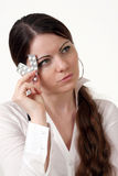 Girl with tabletes. Girl have a headache and going to use tablete Royalty Free Stock Image