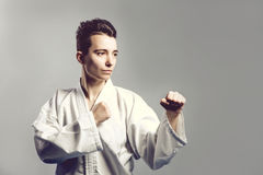 Girl, Taekwondo is martial Stoke hands in fists, focused, serious look in the Studio on gray isolated background Royalty Free Stock Photo