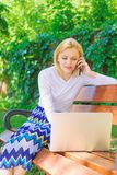 Girl take advantage virtual shopping. Girl sit bench with notebook call phone. Save your time with virtual shopping. Technologies making life easier. Woman royalty free stock images
