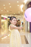 Girl take a balloon Royalty Free Stock Photography