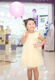 Girl take a balloon Stock Photography