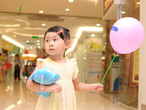 Girl take a balloon Royalty Free Stock Photos