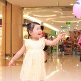 Girl take a balloon Stock Image